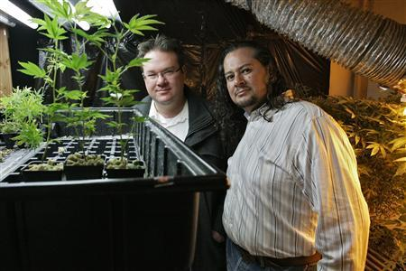 Brennan Thicke (L), a founder of the Venice Beach Care Center, and Rigo Valdez, an organizing director with United Food and Commercial Workers union (UFCW), pose together at the medical marijuana dispensary in Los Angeles, California February 6, 2013. REUTERS/Jonathan Alcorn