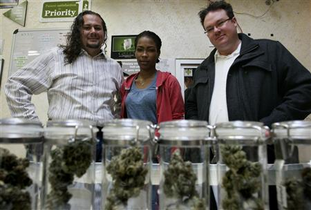 Rigo Valdez (L), an organizing director with United Food and Commercial Workers union (UFCW), Ayrn Taylor, employee and UCFW union member, and Brennan Thicke, a founder of the Venice Beach Care Center, pose together at the medical marijuana dispensary, in Los Angeles, California, February 6, 2013. REUTERS/Jonathan Alcorn