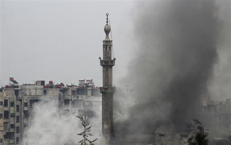 Smoke rises from a mosque and another building during heavy fighting between the Free Syrian Army and President Bashar al-Assad's forces, in the Jobar area of Damascus February 6, 2013. REUTERS/Mohamed Dimashkia