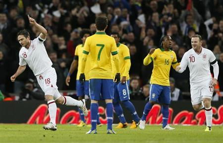 England's Frank Lampard (L) celebrates with team mate Wayne Rooney after scoring against Brazil during their international friendly soccer match at Wembley stadium in London February 6, 2013. REUTERS/Stefan Wermuth