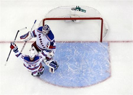 New York Rangers' Brandon Dubinsky celebrates with goalie Henrik Lundqvist after beating the Ottawa Senators in game 3 of their NHL Eastern Conference quarter-final playoff hockey game in Ottawa April 16, 2012. REUTERS/Blair Gable