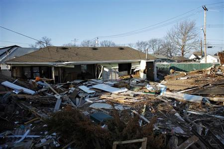 A view of a house destroyed by Superstorm Sandy with its debris still uncleared at Staten Island in New York January 4, 2013. REUTERS/Eduardo Munoz
