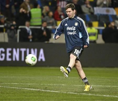 Argentina's Lionel Messi warms up before an international friendly match against Sweden at Friends Arena in Stockholm, Sweden, February 6, 2013. REUTERS/Leo Sellen/Scanpix Sweden