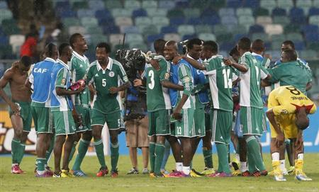 Nigeria's players celebrate their victory over Mali after their African Cup of Nations (AFCON 2013) semi-final soccer match at the Moses Mabhida stadium in Durban February 6, 2013. REUTERS/Mike Hutchings