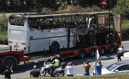 A truck carries a bus, that was damaged in a bomb blast on Wednesday, outside Burgas Airport, about 400km (248miles) east of Sofia July 19, 2012. REUTERS/Stoyan Nenov