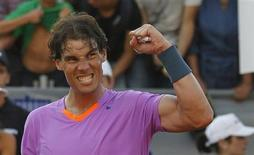 Spain's Rafael Nadal gestures after winning a match against Argentina's Federico Delbonis during their men's singles match at the Chilean Open tennis tournament in Vina del Mar city February 6, 2013. REUTERS/Eliseo Fernandez