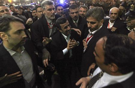 Iran's President Mahmoud Ahmadinejad (C) greets people as he visits the Al-Hussein mosque, named after Prophet Mohammed's grandson Hussein ibn Ali, in old Cairo February 5, 2013. REUTERS/Amr Abdallah Dalsh