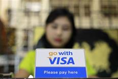 A Visa sign is seen on a cashier's desk at a restaurant in Yangon in this January 31, 2013 file photograph. REUTERS/Soe Zeya Tun/Files