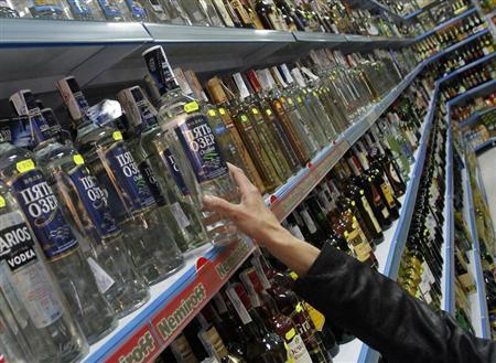 A customer takes a bottle of vodka from a shelf at a Russian supermarket in Benidorm, November 26, 2012. REUTERS/Heino Kalis