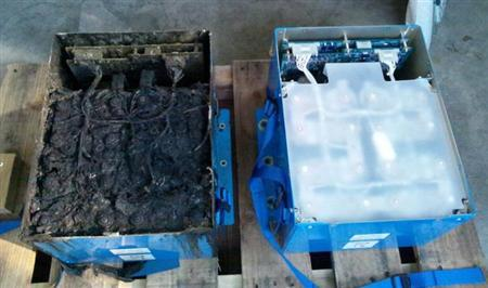 The burnt auxiliary power unit battery (L), removed from an All Nippon Airways' (ANA) Boeing Co 787 Dreamliner plane which made an emergency landing on January 16, 2013 in Takamatsu, is seen next to an undamaged one in this, in this handout photo taken on January 17, 2013 and released by the Japan Transport Safety Board (JTSB) February 5, 2013. REUTERS/Japan Transport Safety Board/Handout