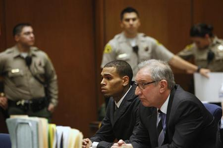 Singer Chris Brown (C) attends a hearing, with attorney Mark Geragos, at Clara Shortridge Foltz Criminal Justice Center in Los Angeles, California February 6, 2013. REUTERS/David McNew/Pool