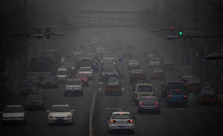 Cars drive along a street on a hazy day in Beijing January 29, 2013. REUTERS/Petar Kujundzic
