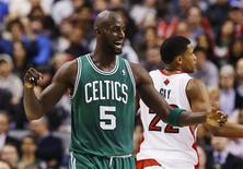 Boston Celtics' Kevin Garnett celebrates against the Toronto Raptors during the first half of their NBA basketball game in Toronto, February 6, 2013. REUTERS/Mark Blinch