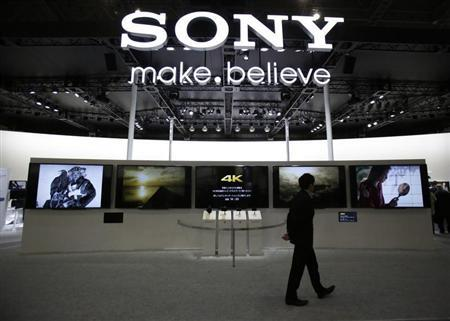 A visitor walks past Sony's booth at the Camera and Photo Imaging Show 2013 in Yokohama, south of Tokyo January 31, 2013. REUTERS/Yuya Shino