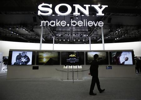 A visitor walks past Sony's booth at the Camera and Photo Imaging Show 2013 in Yokohama, south of Tokyo January 31, 2013. REUTERS/Yuya Shino/Files