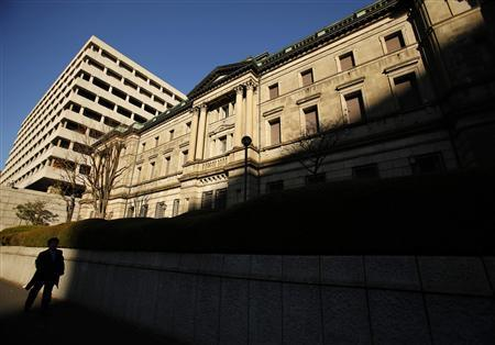 A man walks past the Bank of Japan headquarters in Tokyo, in this file picture taken December 19, 2012. REUTERS/Yuriko Nakao/Files