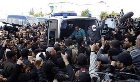 The body of Shokri Belaid, a prominent Tunisian opposition politician, is carried into an ambulance after he was shot, in Tunis February 6, 2013. REUTERS/Zoubeir Souissi