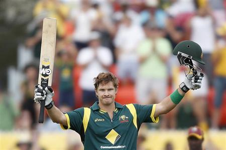 Australia's Shane Watson celebrates reaching a century against the West Indies during their one-day international cricket match at Manuka Oval in Canberra February 6, 2013. REUTERS/Tim Wimborne