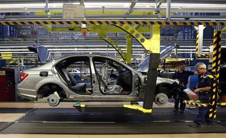 Workers assemble a Mercedes-Benz C-class car at their plant in Sindelfingen near Stuttgart February 5, 2013. REUTERS/Michael Dalder