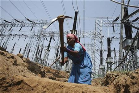 A labourer works at the construction site of a grid power station in Jammu May 5, 2011. REUTERS/Mukesh Gupta/Files