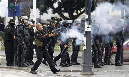 A police officer fires teargas to break up a protest during a demonstration in Tunis February 6, 2013. REUTERS/ Zoubeir Souissi
