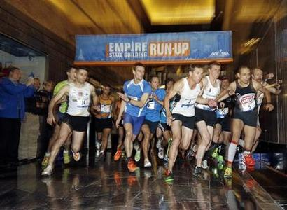 The men's invitational runners participate during the start of the 36th Empire State Building Run-Up running race in New York, February 6, 2013. EUTERS/Adam Hunger