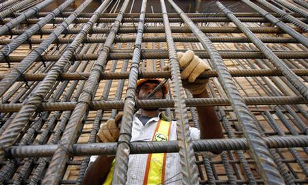 A Delhi Metro Rail Corporation employee works at the final tunnelling breakthrough of Qutub Minar and Saket stations in New Delhi June 17, 2009. REUTERS/Adnan Abidi/Files