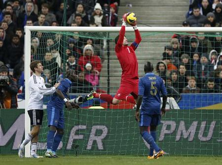 France's Hugo Lloris (2ndR) jumps to make a save during their international friendly soccer match against Germany at the Stade de France stadium in Saint-Denis, near Paris, February 6, 2013. REUTERS/Charles Platiau