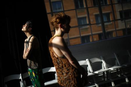 Models stand in the sun before the Degen Autumn/Winter 2013 collection show during New York Fashion Week, February 6, 2013. REUTERS/Eric Thayer