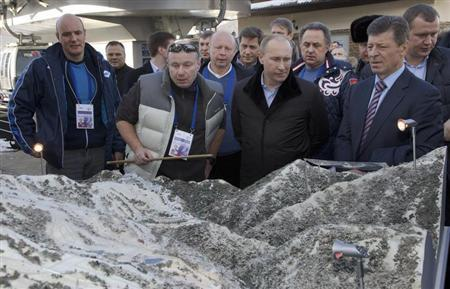 Russia's President Vladimir Putin (2nd R) listens to Interros Company President Vladimir Potanin (2nd L), with Sochi 2014 chief Dmitry Chernyshenko (L) and deputy Prime Minister Dmitry Kozak (R) standing nearby, as he visits the Rosa Khutor Alpine Center in Rosa Khutor outside the Black Sea resort of Sochi, February 6, 2013. REUTERS/Ivan Sekretarev/Pool