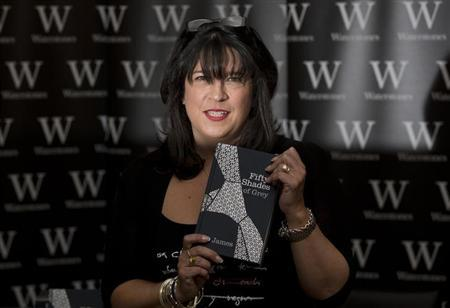 E L James, author of Fifty Shades of Grey, poses for photographers during a book signing in London September 6, 2012. REUTERS/Neil Hall/Files