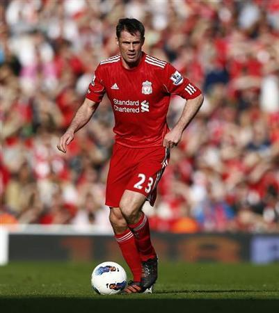 Liverpool's Jamie Carragher runs with the ball during their English Premier League soccer match against Wigan Athletic at Anfield in Liverpool, northern England, March 24, 2012. REUTERS/Phil Noble