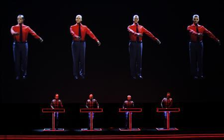 German electronic band Kraftwerk perform with a 3d stage set at the Tate Modern in London February 6, 2013. REUTERS/Luke MacGregor