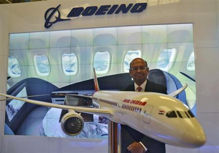 Dinesh Keskar, Boeing's vice-president for sales in Asia Pacific and India, poses with a model of 787 Dreamliner during ''Aero India 2013'' on the outskirts of Bangalore February 7, 2013. REUTERS/Stringer