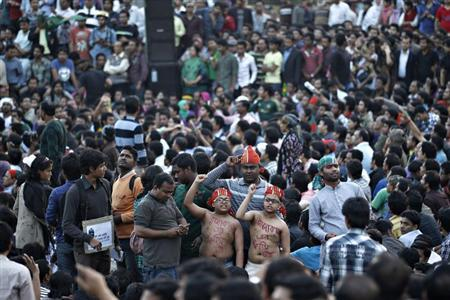 People attend a sit-in protest at Shahbagh intersection, demanding capital punishment for Bangladesh's Jamaat-e-Islami senior leader Abdul Quader Mollah, after a war crimes tribunal sentenced him to life imprisonment, in Dhaka February 6, 2013. REUTERS/Andrew Biraj