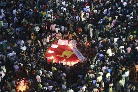 People attend a sit-in protest at Shahbagh intersection, demanding capital punishment for Bangladesh's Jamaat-e-Islami senior leader Abdul Quader Mollah, after a war crimes tribunal sentenced him to life imprisonment, in Dhaka February 7, 2013.REUTERS/Andrew Biraj