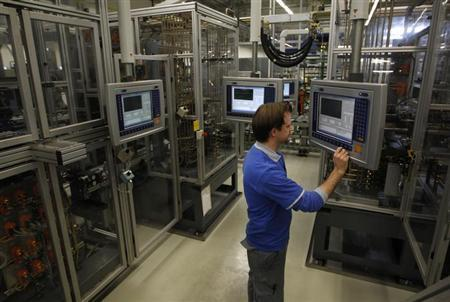 A worker controls the production of steering gears at a plant of Germany's industrial conglomerate ThyssenKrupp AG in the western city of Muelheim January 16, 2013.REUTERS/Ina Fassbender (GERMANY - Tags: BUSINESS INDUSTRIAL)