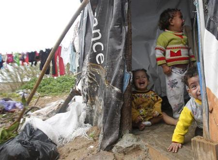 Syrian children cry inside a tent at a refugee camp in the city of Tyre, in southern Lebanon January 31, 2013. REUTERS/Ali Hashisho
