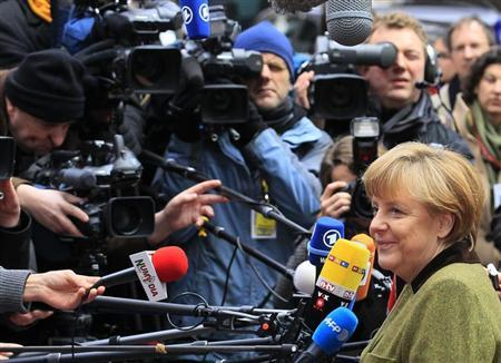 Germany's Chancellor Angela Merkel arrives at the EU council headquarters for an European Union leaders summit meeting to discuss the European Union's long-term budget in Brussels February 7, 2013. European Union leaders begin two days of talks on a long-term budget on Thursday, with efforts to refocus spending on growth likely to be thwarted by demands for farm subsidies as pressure to reach a deal grows. REUTERS/Yves Herman (BELGIUM - Tags: POLITICS BUSINESS)