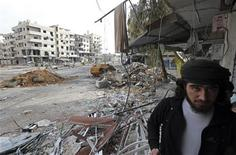 A Free Syrian Army fighter walks in the Haresta neighbourhood of Damascus February 7, 2013. REUTERS/Goran Tomasevic