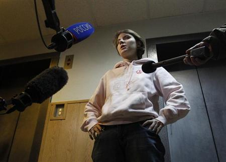 Yekaterina Samutsevich, the member of Pussy Riot who was released from jail after her sentence was suspended on appeal, speaks to the media before a court hearing in Moscow November 20, 2012. REUTERS/Maxim Shemetov