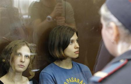 Members of the female punk band ''Pussy Riot'' Nadezhda Tolokonnikova (R) and Maria Alyokhina sit in a glass-walled cage during a court hearing in Moscow, August 17, 2012. REUTERS/Maxim Shemetov