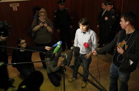 Yekaterina Samutsevich, a member of punk group Pussy Riot released from jail after her sentence was suspended on appeal, speaks to the media before a court hearing in Moscow January 30, 2013. REUTERS/Mikhail Voskresensky