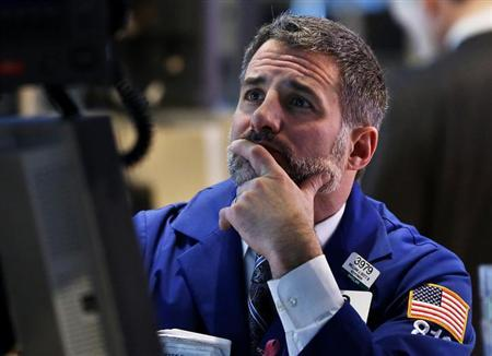 A trader works on the floor of the New York Stock Exchange, February 6, 2013. REUTERS/Shannon Stapleton (UNITED STATES - Tags: BUSINESS)