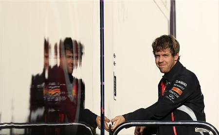 Red Bull Formula One driver Sebastian Vettel of Germany is seen in the paddock during a training session at the Jerez racetrack in southern Spain February 7, 2013. REUTERS/Marcelo del Pozo