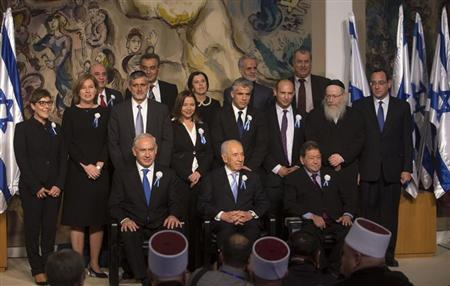 Israel's President Shimon Peres (C, seated) sits between Prime Minister Benjamin Netanyahu (L, seated) and Labour party lawmaker Binyamin Ben-Eliezer (R, seated) as party leaders of the 19th Knesset, the new Israeli parliament, pose for a group photo at a reception following their swearing-in ceremony in Jerusalem February 5, 2013. REUTERS/Ronen Zvulun