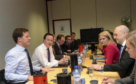 Britain's Prime Minister David Cameron (2nd L), Denmark's Prime Minister Helle Thorning Schmidt (2nd R), the Netherlands' Prime Minister Mark Rutte (L) , Sweden's Prime Minister Fredrik Reinfeldt attend a meeting during an European Union leaders summit meeting to discuss the European Union's long-term budget in Brussels February 7, 2013. European Union leaders began two days of high-pressure talks on a long-term budget on Thursday, with efforts to refocus spending on growth likely to be thwarted by demands for farm subsidies. REUTERS/Laurent Dubrule (BELGIUM - Tags: POLITICS BUSINESS)