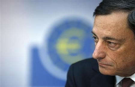 European Central Bank (ECB) President Mario Draghi listens during the monthly ECB news conference in Frankfurt February 7, 2013. The European Central Bank left interest rates unchanged on Thursday and President Mario Draghi was set to face a grilling at a press conference over the ECB's sensitivity to a sharp rise in the euro and his connection to an Italian banking scandal. REUTERS/Lisi Niesner (GERMANY - Tags: BUSINESS HEADSHOT)