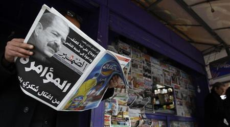 A man reads a local newspaper, displaying a picture of assassinated prominent Tunisian opposition politician Chokri Belaid, at a kiosk in Tunis February 7, 2013. REUTERS/Zoubeir Souissi