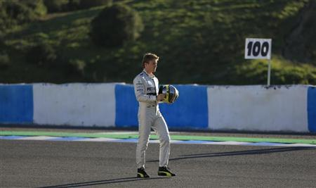 Mercedes Formula One racing driver Nico Rosberg of Germany walks at the Jerez racetrack in southern Spain February 4, 2013. REUTERS/Marcelo del Pozo
